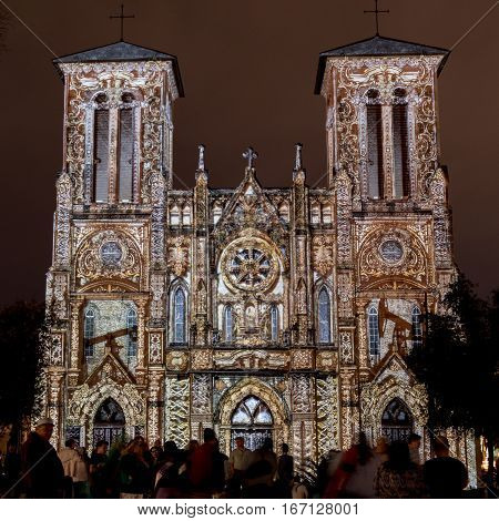 January 21 2017: San Antonio Texas: San Fernando Cathedral Lights up with an Ornate public art light show with crowd watching
