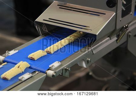 Production line of baking bars cookies close up
