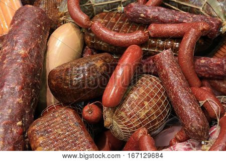 lot of different sausages and salami closeup. stale sausages with mold