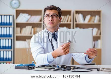 IT technician repairing broken laptop notebook computer