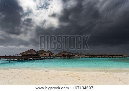 Water Bungalows At Rainy Season. Maldives Islands