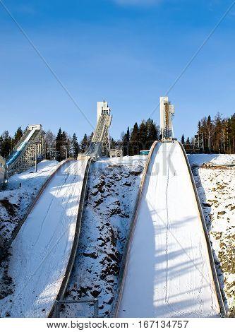 Complex of ski springboards against the blue sky in city Nizhniy Tagil. Russia