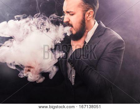 Smoker Man coughing on black. vapor concept
