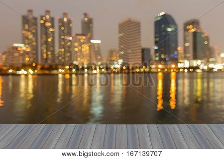 Opening wooden floor blurred lights office building and reflection at night