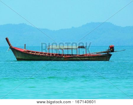 Traditional longtail boats in Phuket in the Andaman Sea, Thailand