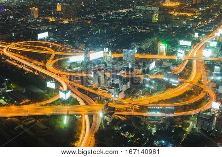 Night light Highway intersection aeril view Bangkok city downtown Thailand