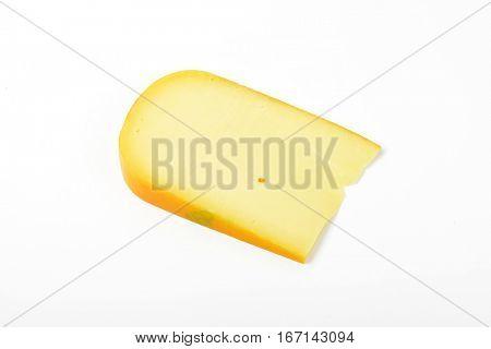 slice of gouda cheese on white background