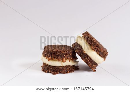 Photo of cookies made from healthy ingredients that are acceptable in raw vegan and paleo lifestyle. Image on the white background.