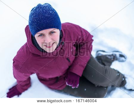 Beautiful Woman Blowing In The Snow In A Pine Forest