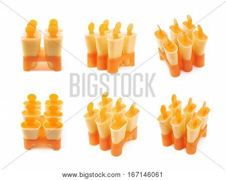 Plastic orange popsicle ice lolly form molds set isolated over the white background, set of six different foreshortenings