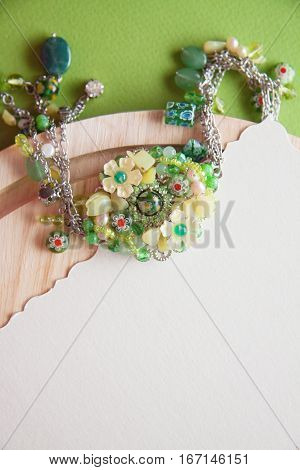 vintage colorful background with granny`s green necklace. Memories concept photo with copy space