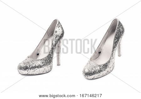 Shining silver high-heeled footwear shoe isolated over the white background, set of two different foreshortenings