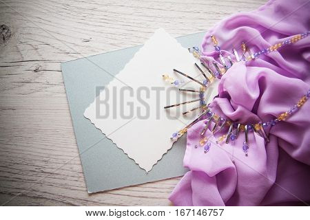 elegant background for design including postcard for text drapery and metal necklace