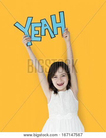 Young girl wearing yeah word