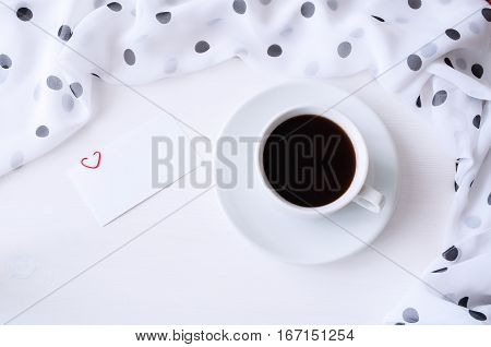 St Valentines day background - cup of coffee and blank love card, romantic St Valentines day concept