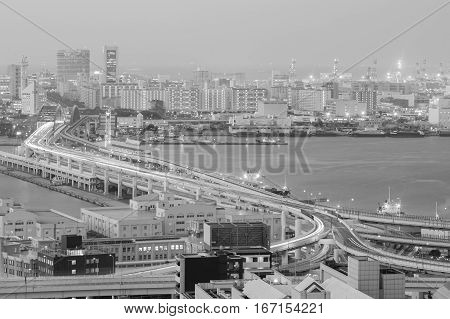 Black and White Twilight aerial view Kobe city central business and highway intersection over sea port Japan
