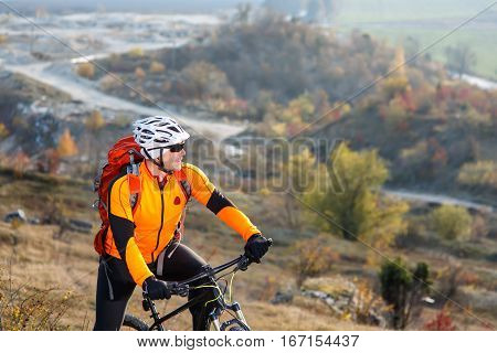 Mountain Bike traveler riding single track at foggy morning on hills. healthy lifestyle active athlete riding wild countryside. Cycle traveling concept.