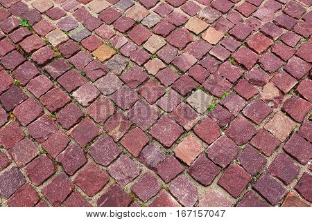red granite pavers on the sidewalk in the city