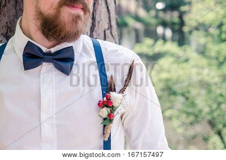 Man with a bow tie. Wedding Boutonniere.