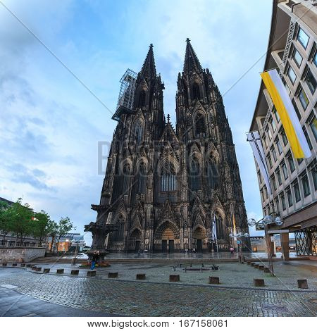 Cologne Cathedral on the west side and Square Roncalli in Cologne, Germany. The Dom - Roman Catholic Gothic cathedral