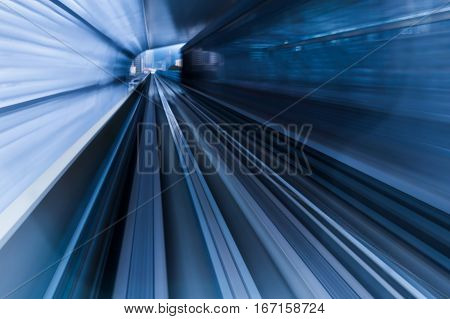 Moving train out of tunnel blurred motion background
