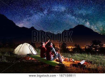 Female Tourist Shows On The Starry Sky And Milky Way