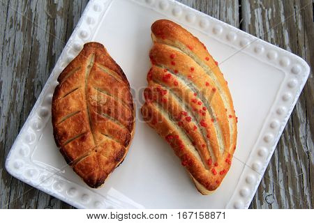 Image of two flavorful fancy pastry, each a puff pastry with filling