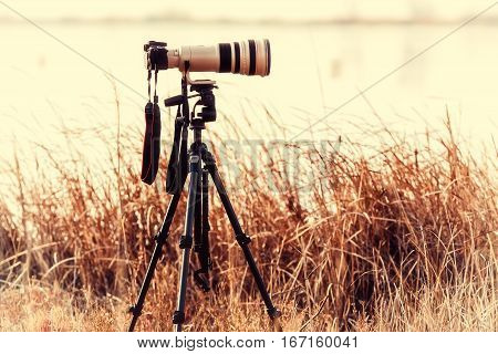 Professional Camera With Telephoto Lens On A Tripod During Landscape Photography Outdoor.