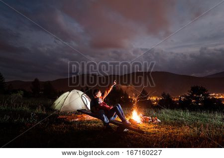 Man Shows His Lover In The Evening Cloudy Sky