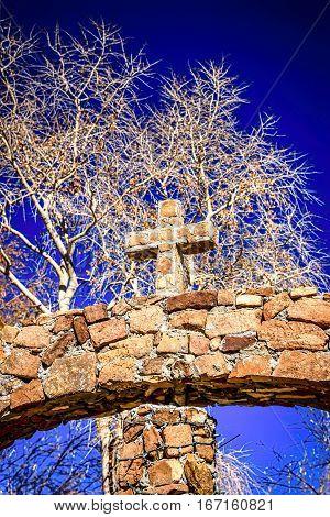 Chimayo, New Mexico, USA - December 7: Christian symbol of the cross at Santuario de Chimayo in New Mexico