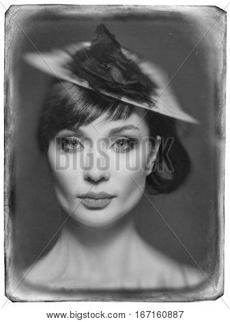 Girl swinging on a swing in the Studio in the expensive evening dresses.Grunge film framed.Black and white pictures.