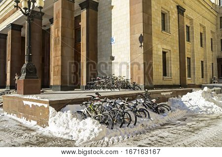Big group of bicycles left for the winter near the entrance to the main building of Moscow State University.