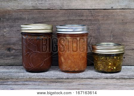 Canned preserves and relish against distressed background