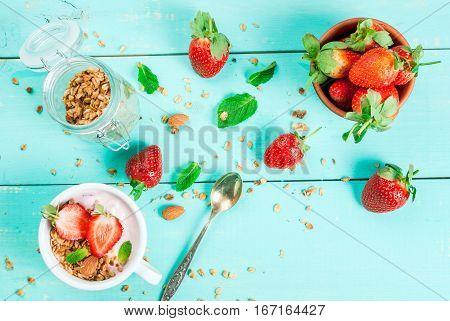 Yogurt With Granola, Nuts And Fresh Strawberry