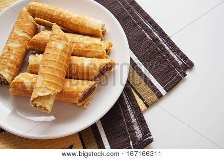pieces of rolled viennese waffles on white plate