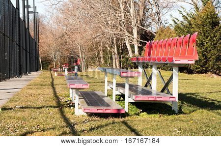 sets of small bleachers by a local high schools tennis courts
