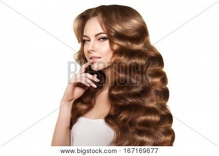 Long hair. Waves Curls updo Hairstyle.   Fashion model, woman with shiny healthy hair from salon.Girl with luxurious haircut. Girl with hair volume.