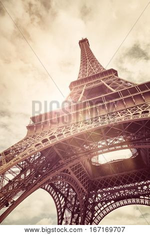 The Eiffel Tower, Paris. Filtered, matte finish with light leaks and lens flare, processed to look like a faded 1970s style image.