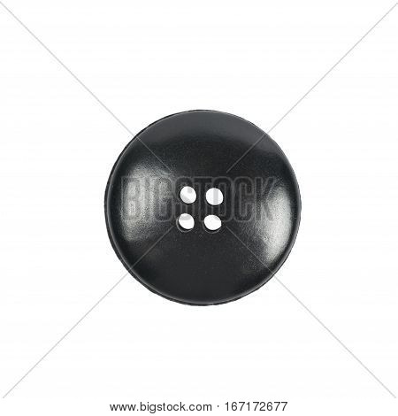 Single black clothing button isolated over the white background