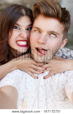 Happy Stylish Couple Taking Selfie And Having Fun Emotions At Old European City Street, Hilarious Mo