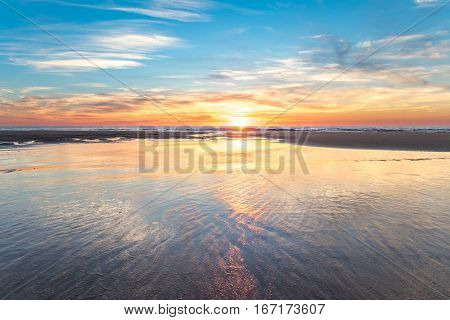 Beautiful sunset at the beach during a winter evening.