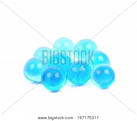 Pile of blue soil water beads isolated over the white background
