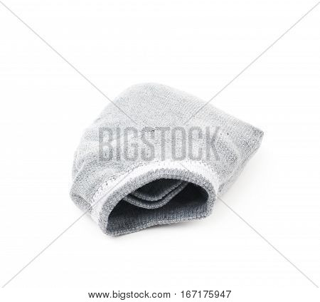 Folded pair of gray low-cut ped socks isolated over the white background