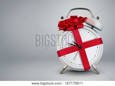 Clock in gift ribbon time to gift cocept copy space.