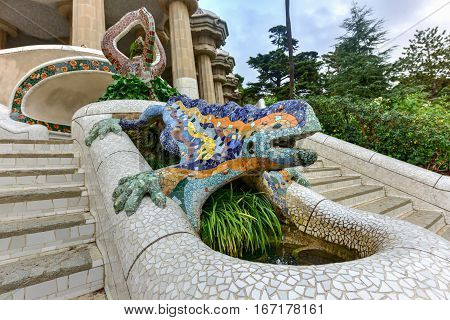 Barcelona, Spain - November 29, 2016: Lizard in Park Guell in Barcelona Spain is a public park system composed of gardens and architectonic elements located on Carmel Hill in Barcelona Catalonia (Spain).