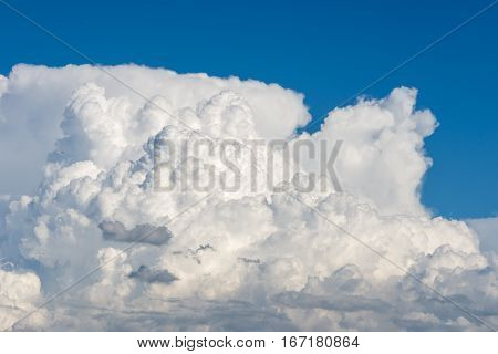 Cumulus clouds forming on blue summer day