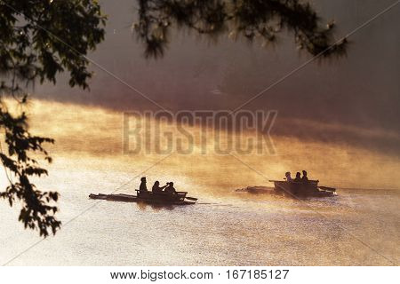silhouette of tourist bamboo rafting in pang ung at morning mist most popular winter traveling destination in maehongson northern of thailand