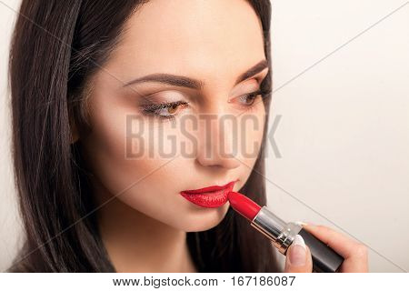 Red Lipstick. Closeup Of Woman Face With Bright Red Matte Lipstick On Full Lips. Beauty Cosmetics, Makeup Concept. High Resolution Image.