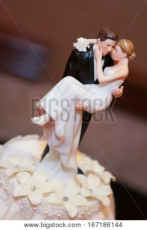 A bride and groom wedding cake topper