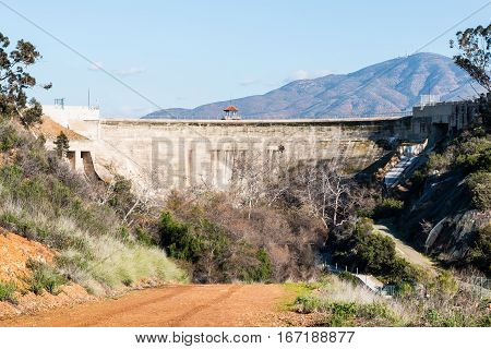 Close-up view of Sweetwater dam with road and San Miguel Mountain in the background in San Diego, California.